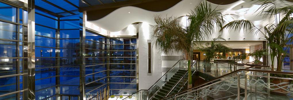A shot of the futuristic split-level lobby at the Elba Carlota