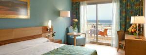 Habitación Familiar en Hotel Elba Carlota